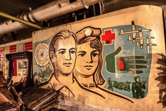 Plakatai ant sienų